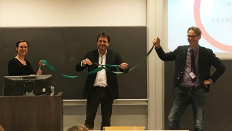 Gert-Jan Burgers, director of CLUE+, ties a ceremonial knot to symbolize the center's aim to connect various disciplines and communities.
